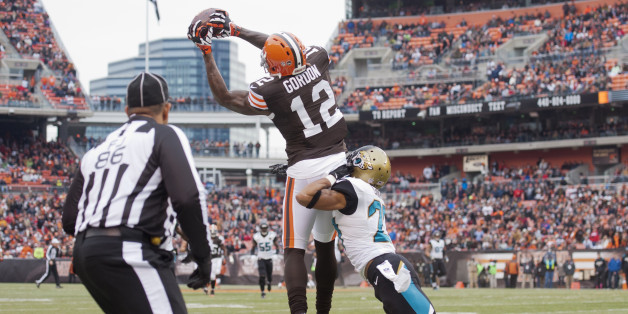 CLEVELAND, OH - DECEMBER 1: Wide receiver Josh Gordon #12 of the Cleveland Browns catches a pass under pressure from cornerback Dwayne Gratz #27 of the Jacksonville Jaguars during the first half at FirstEnergy Stadium on December 1, 2013 in Cleveland, Ohio. (Photo by Jason Miller/Getty Images)