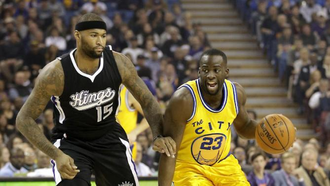 Golden State Warriors forward Draymond Green, right, drives against Sacramento Kings forward DeMarcus Cousins during the first quarter of an NBA basketball game Saturday, Jan. 9, 2016, in Sacramento, Calif. The Warriors won 128-116.(AP Photo/Rich Pedroncelli)