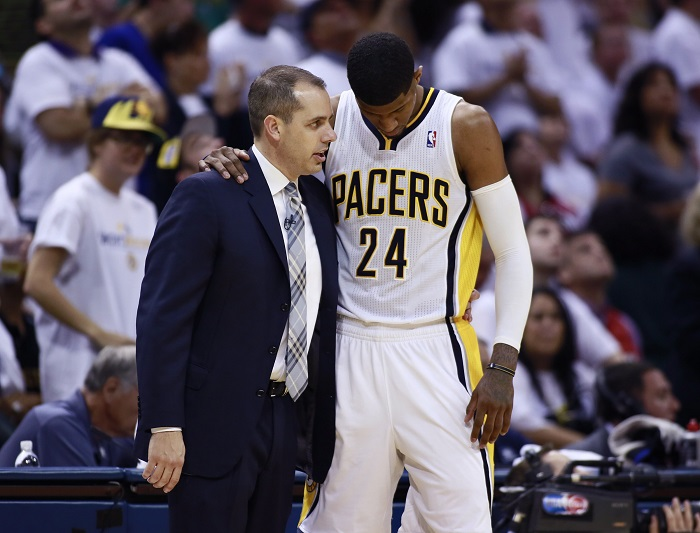 Indiana Pacers' head coach Frank Vogel confers with his player Paul George in the second half of Game 3 of the NBA Eastern Conference final basketball playoff series against the Miami Heat in Indianapolis, Indiana, May 26, 2013.  REUTERS/Brent Smith (UNITED STATES  - Tags: SPORT BASKETBALL)   - RTX102I8