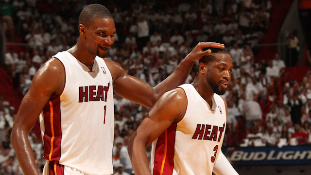 MIAMI, FL - April 20:  Chris Bosh #1 and Dwyane Wade #3 of the Miami Heat celebrate against the Charlotte Bobcats during Game One of the Eastern Conference Quarterfinals of the 2014 NBA playoffs at the American Airlines Arena in Miami, Florida on April 20, 2014. NOTE TO USER: User expressly acknowledges and agrees that, by downloading and/or using this photograph, user is consenting to the terms and conditions of the Getty Images License Agreement. Mandatory copyright notice: Copyright NBAE 2014 (Photo by Issac Baldizon/NBAE via Getty Images)