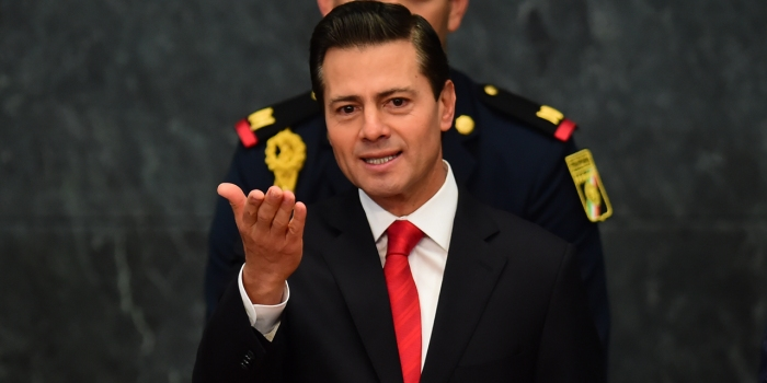 "Mexican President Enrique Pena Nieto gives a foreign policy speech after US President Donald Trump vowed to start renegotiating North American trade ties, in Mexico City on January 23, 2017. Trump's vows to scrap the North American Free Trade Agreement to protect US jobs have raised concern in Mexico, which sends most of its exports to the United States. Pena Nieto's office said he congratulated Trump on taking office in a phone call Saturday and that both had agreed to open a ""new dialogue."" / AFP PHOTO / Ronaldo SCHEMIDT"